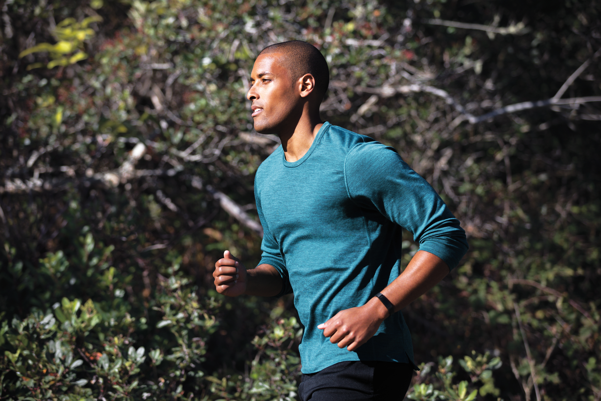 Alta HR lifestyle shot featuring a man running while wearing the special edition Alta HR in gunmetal.